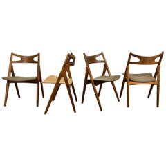 Hans J. Wegner Set of Four Sawbuck Chairs, Early Set in Oak, circa 1952, Denmark