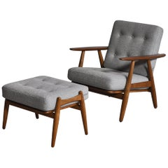 Hans J. Wegner Set of Lounge Chair Model GE-240 & Ottoman in Oak and Teak, 1950s