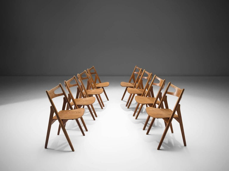 Hans J. Wegner for Carl Hansen & Søn, set of eight 'Sawbuck' CH29 chairs, oak, Denmark, 1952.  This set of eight chairs is designed by Hans J. Wegner for Carl Hansen. This chair holds a very strong construction even though it has a simplistic