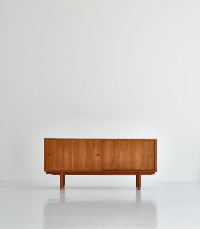 Rare sideboard designed by Hans J. Wegner and made at master cabinetmaker Johannes Hansens workshop. The sideboard is made for freestanding in the room and is in great condition.