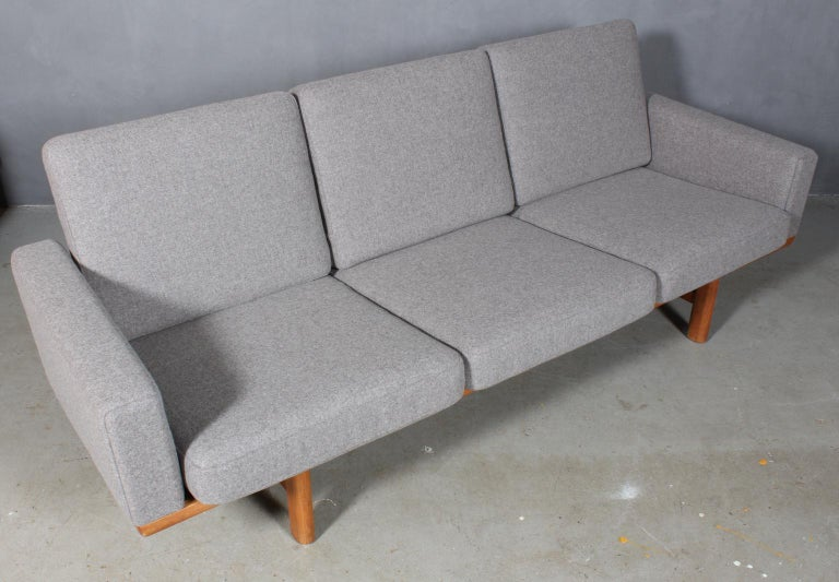 Hans J. Wegner three-seat sofa new upholstered with Divina wool in 100 % New Zealand wool.