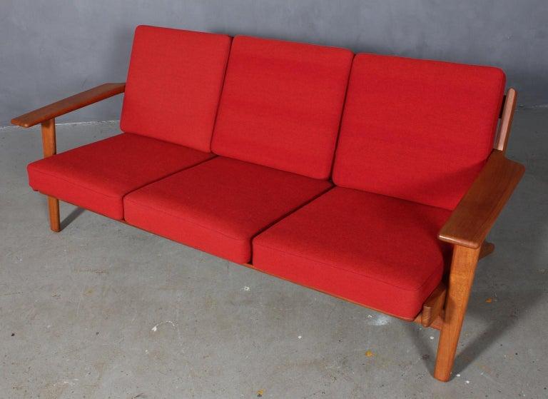 Hans J. Wegner three-seat sofa made of solid teak.  Original Epeda cushions, with original Kvadrat Hallingdal upholstery.  Model 290, made by GETAMA.