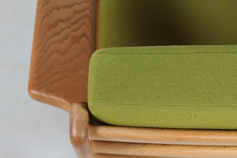 Danish Hans J. Wegner Two Lounge Chairs GE 290 of Oak and Green Wool by GETAMA, 1970s For Sale