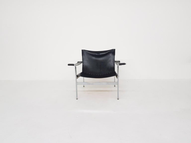 Chrome lounge chair with black leather seating, arm rests and back. Seating cushion is re-upholstered in black leather.