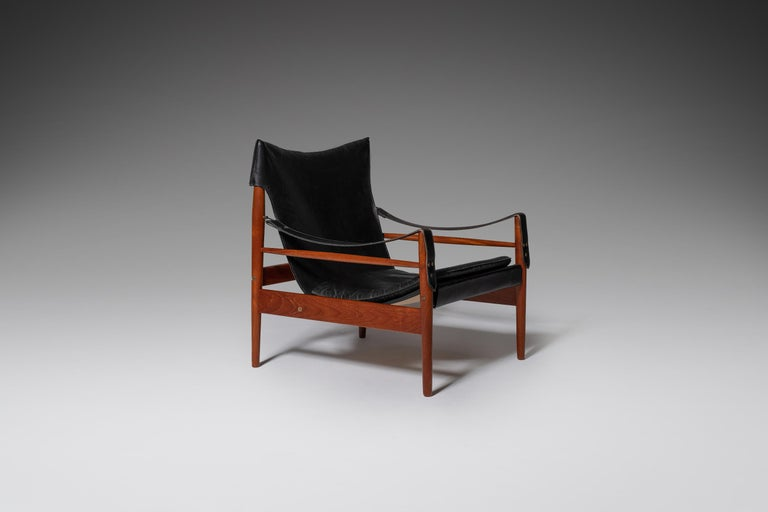 """Remarkable """"Antilope"""" Safari or Hunting lounge chair by Hanson Olsen, produced by Viskadalens möbler, Denmark 1960s. The chair consist out of an elegant and solid teak frame which holds a beautiful patinated leather seat which is nicely folded"""