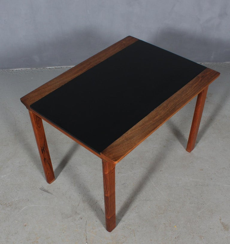 Hans Olsen coffee table / side table of rosewood and leather.