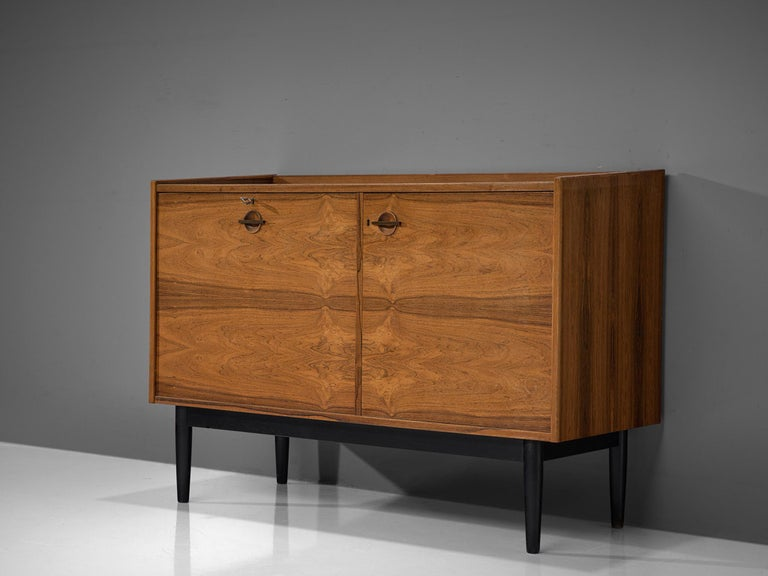 Hans Olsen for Brande Mobler, bar cabinet, rosewood and metal, Denmark, 1960s  A unique piece by designer Danish Hans Olsen provides varied storage facilities designed to be used as a dry bar. On the left bottle holders are integrated into the