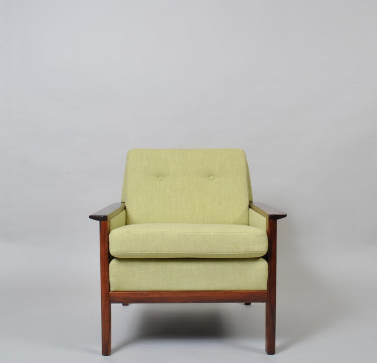 A fully reupholstered Danish midcentury lounge chair by Hans Olsen. Produced by CS Mobler, Denmark, circa 1950s. Wonderful wing arms and wood frame. The entire chair has been completely reupholstered from scratch in Linwood fabric. Classic armchair