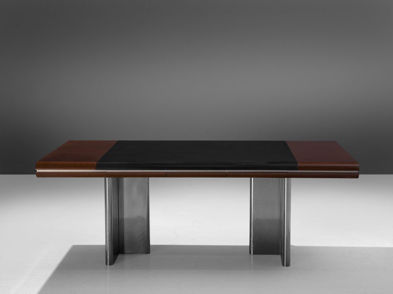 Hans Von Klier for Skipper, office table, mahogany, leather and metal, Italy, 1970s.  Modern desk designed by Hans Von Klier for Skipper, Italia. The table consists of a rectangular shaped wooden top with a steel strip and inlayed with black