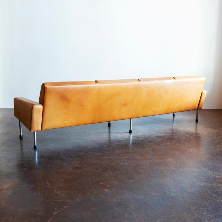 Hans Wegner freestanding four-seat Airport sofa, model AP 34/4, in cognac patinated leather. Designed in 1954 and manufactured by AP Stolen, Denmark, 1960s.