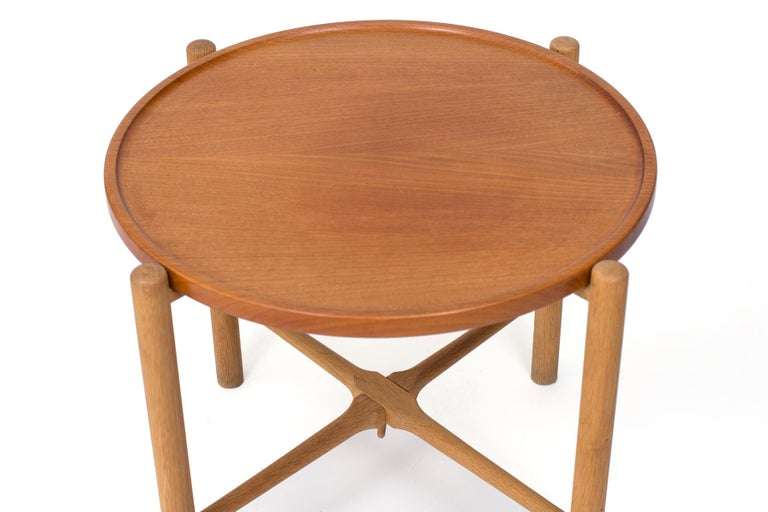Hans Wegner for Andreas Tuck side table, circa late 1950s. This all original example has a collapsible base and removable top. It is executed in teak and beech.