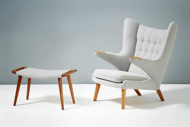 Hans J. Wegner  AP-19 Papa Bear chair and AP-29 ottoman, 1953  One of Wegner's most iconic designs. Produced by A.P. Stolen, Denmark. Oak 'paws' and legs on the armchair and matching oak legs and handles on the ottoman. These examples have been