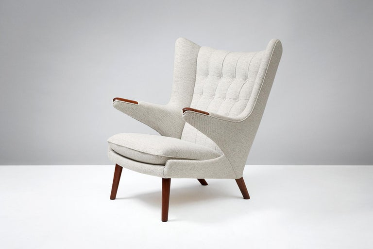 Hans J. Wegner  AP-19 papa bear chair, 1953  One of Wegner's most iconic designs. Produced by A.P. Stolen, Denmark. Teak paws and legs. Chair recovered in Kvadrat Hallingdal wool fabric.