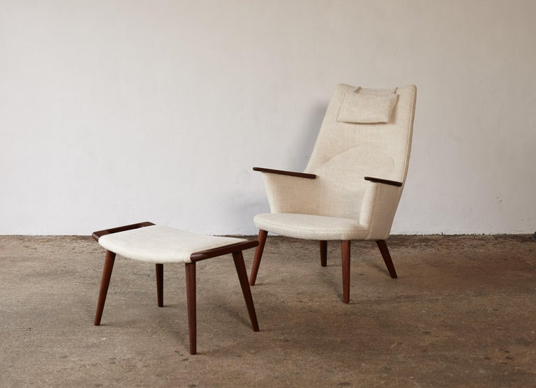 A wonderful Hans Wegner AP-27 chair (sometimes called Mama Bear Chair) and ottoman, AP Stolen, Denmark, 1950s. Recovered in Pierre Frey fabric. Very good condition. Stamped with makers mark.  Ships worldwide.