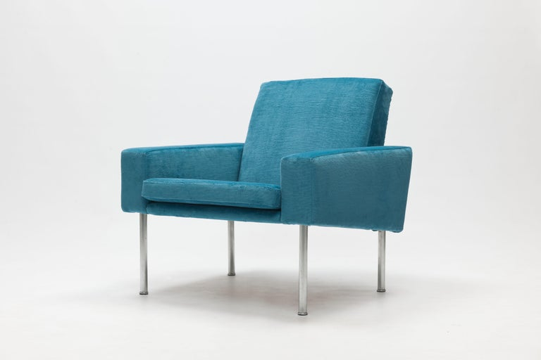 Lounge chair model AP34 by Danish designer Hans Wegner, designed in 1957 as a part of a series that included a 2, 3 and 4 seater sofa.  Fully upholstered frame with loose seat cushion with legs of brushed stainless steel. Executed by 1st