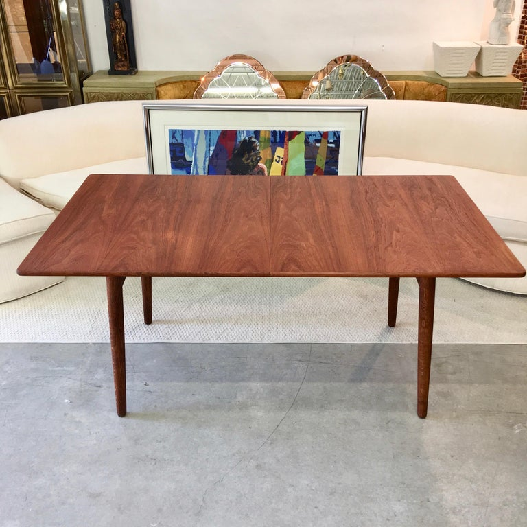 Model AT310 dining table by Hans J. Wegner (1914-2007) for Andreas Tuck, Denmark. Oil rubbed teak top with two 16