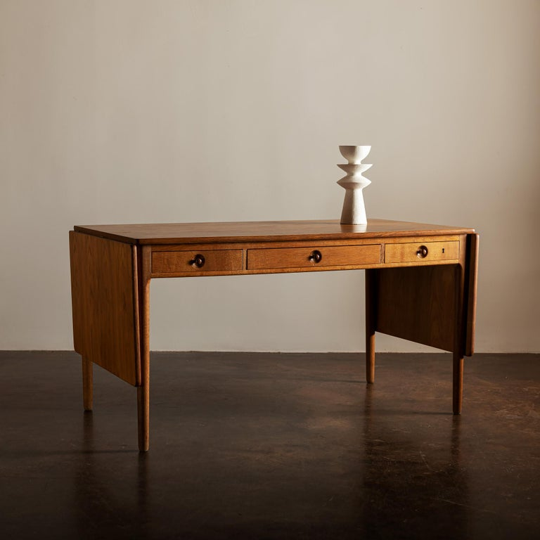 Handsome AT305 desk in oak, with three drawers and 19