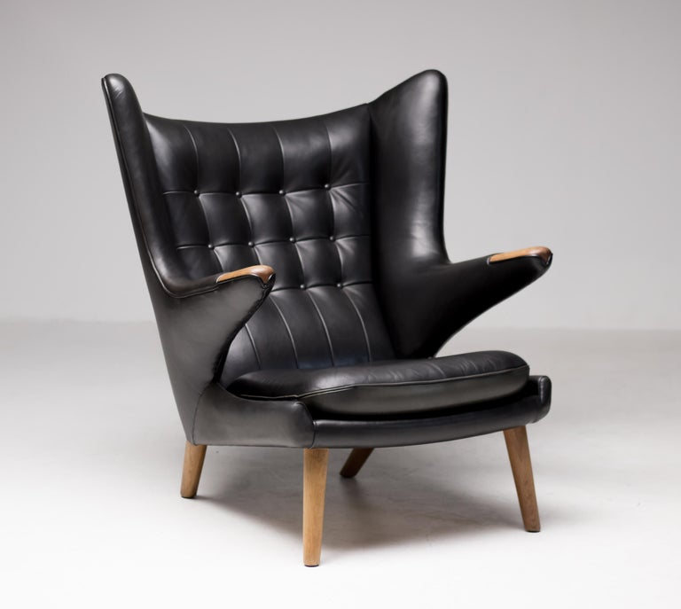 Hans J. Wegner black leather pair of Papa Bear chairs with one ottoman for A.P. Stolen, circa 1950. Great pampered condition, the natural dye black leather is still very soft and supple. Priced as a set.  Provenance:  Klassik Copenhagen Danish