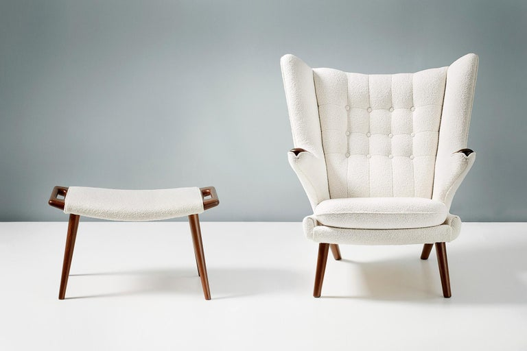 Hans J. Wegner  AP-19 Papa Bear chair and AP-29 ottoman, 1953  One of Wegner's most iconic designs. Produced by A.P. Stolen, Denmark with dark teak arms and legs on the armchair and handles on the matching ottoman. These examples have been