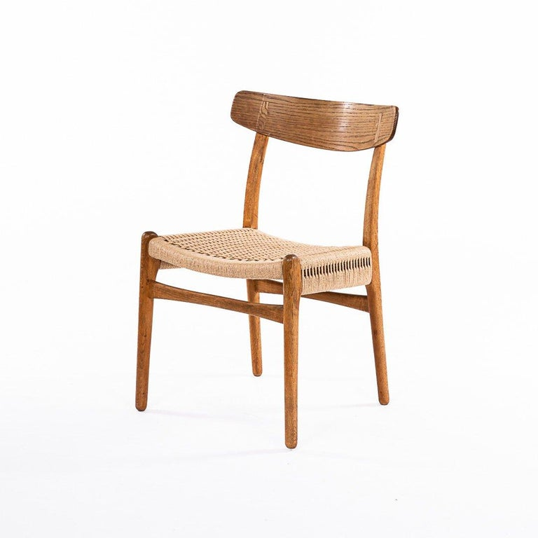 Set of six chairs, in solid oak with papercord seats. Designed by Hans J. Wegner for Carl Hansen & Son, Odense. Labeled by the maker. Great condition.   Literature: Dansk Kunsthåndværk No. 11, November 1950, p. 195-196. (Danish magasin for Arts