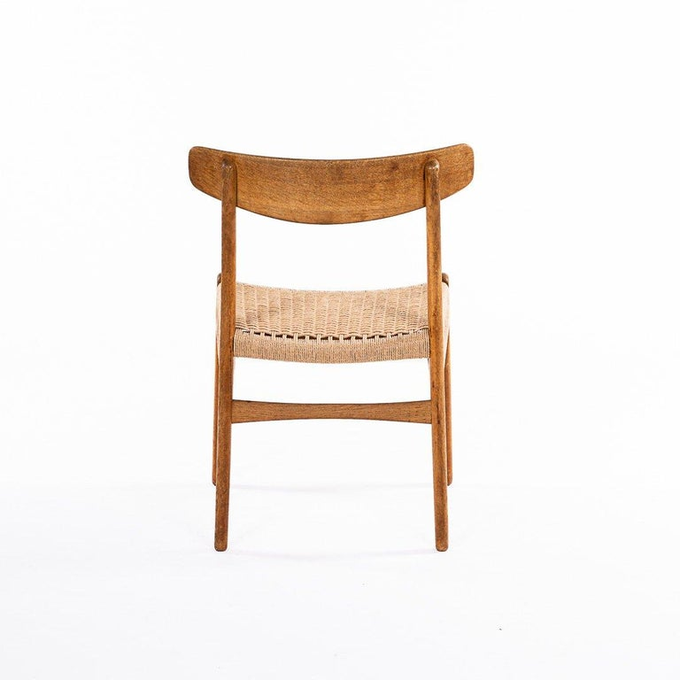 Hans Wegner CH 23 Chairs in Oak and Papercord, Denmark 1950s, Set of 6 In Good Condition For Sale In Madrid, ES