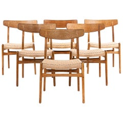 Hans Wegner CH 23 Chairs in Oak and Papercord, Denmark 1950s, Set of 6