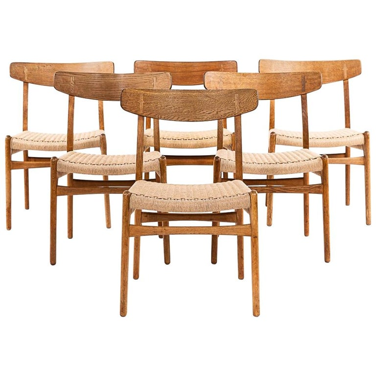 Hans Wegner CH 23 Chairs in Oak and Papercord, Denmark 1950s, Set of 6 For Sale