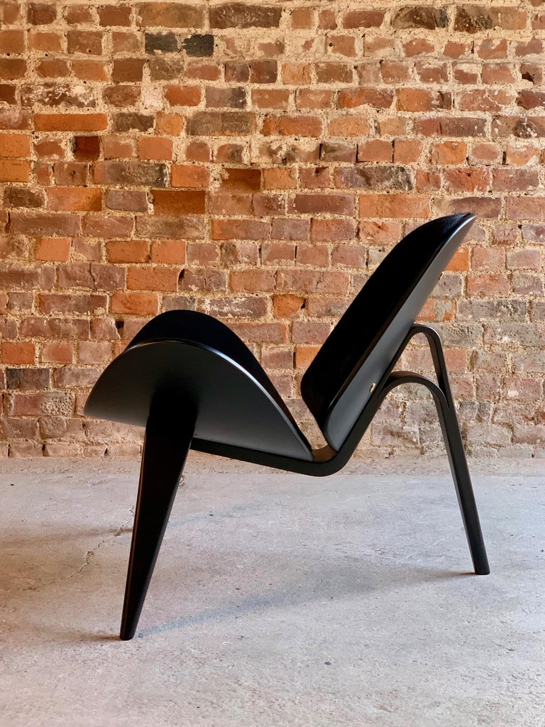 Hans Wegner CH07 shell chair by Carl Hansen & Son, Denmark, circa 1990  Hans Wegner CH07 pony hide and satin black shell chair by Carl Hansen circa 1990, the chair has been completely restored and recovered in black short haired pony hide,