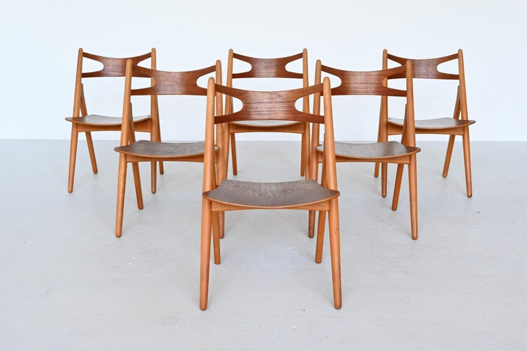 """Amazing set of 6 iconic model CH29 dining chairs designed by Hans J. Wegner and manufactured by Carl Hansen & Søn, Denmark 1952. This design Classic is also called """"Sawbuck chair"""" because the model resembles a sawhorse. The sawhorse was"""