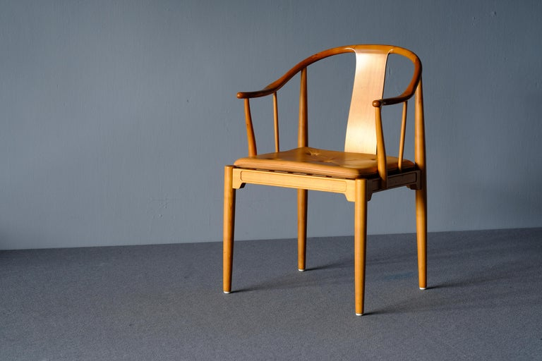 """""""China Chair"""" by Hans Wegner for Fritz Hansen. This is in cherry and the loose cushions are in patinated natural leather. Probably the most comfortable chairs you can find. A fantastic addition to any serious collection. The maker's stamp is affixed"""