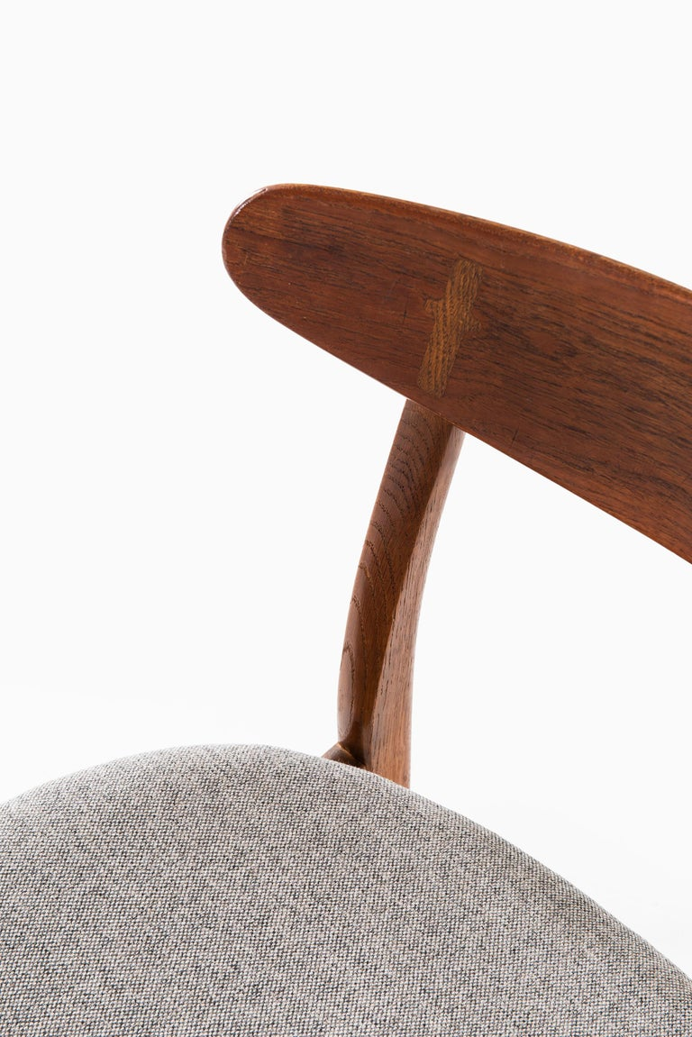 Set of 11 dining chairs model CH-30 designed by Hans Wegner. Produced by Carl Hansen & Son in Denmark.