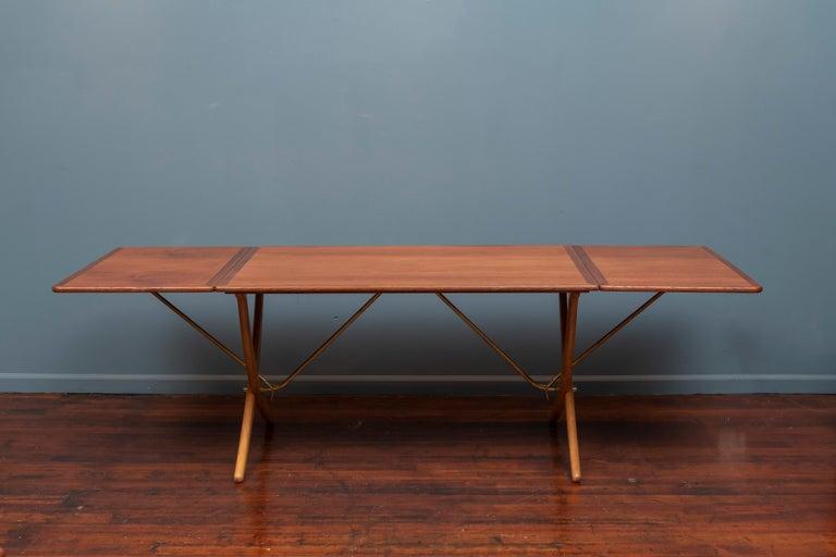 Hans Wegner design saber leg oak drop leaf dining table, model AT 304. Newly refinished and stamped with maker's mark, Denmark. Table is 94