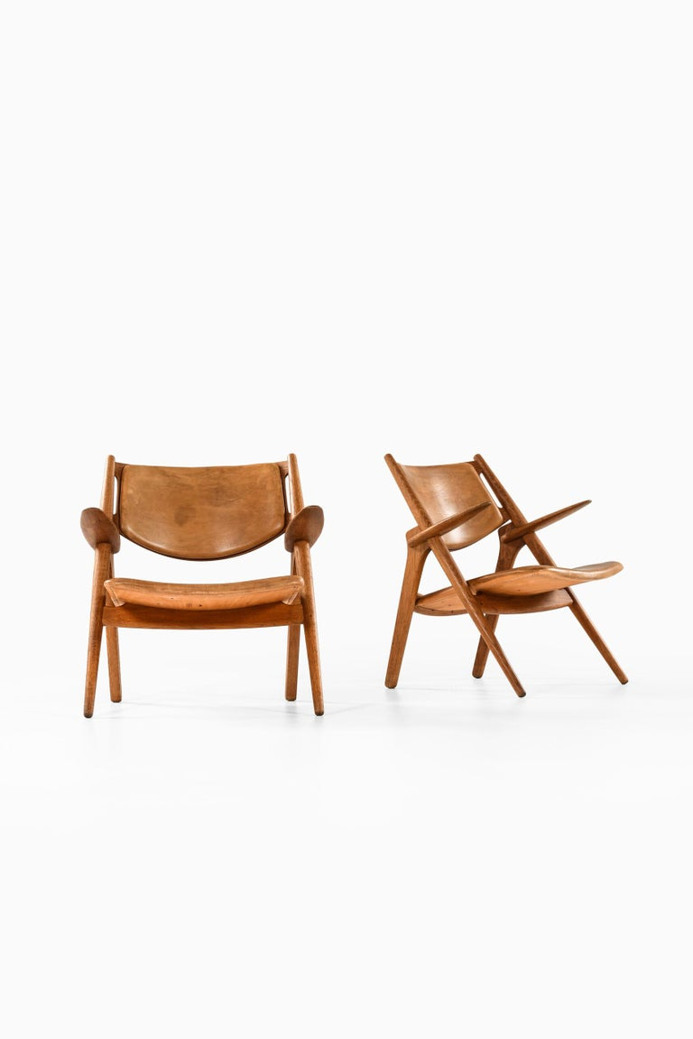 Rare pair of easy chairs model CH-28 designed by Hans Wegner. Produced by Carl Hansen & Søn in Denmark.