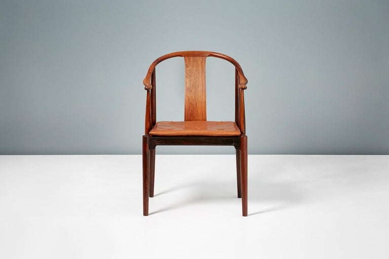 Hans J. Wegner  FH 4283 China chair, 1944  Produced by Fritz Hansen in Denmark this version in exquisite Brazilian rosewood is an incredibly rare version of this iconic design made in limited quantities in the 1960s. The loose seat cushion is