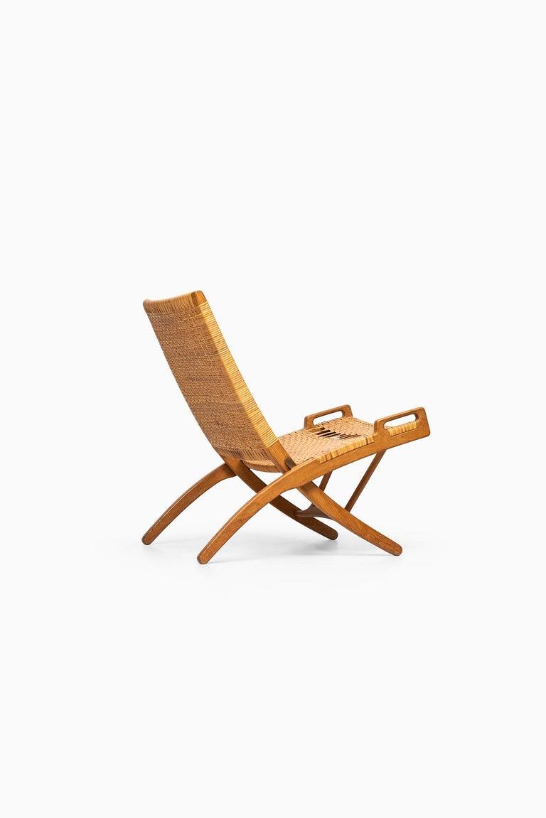 Hans Wegner Folding Chair Model JH512 by Johannes Hansen in Denmark 3