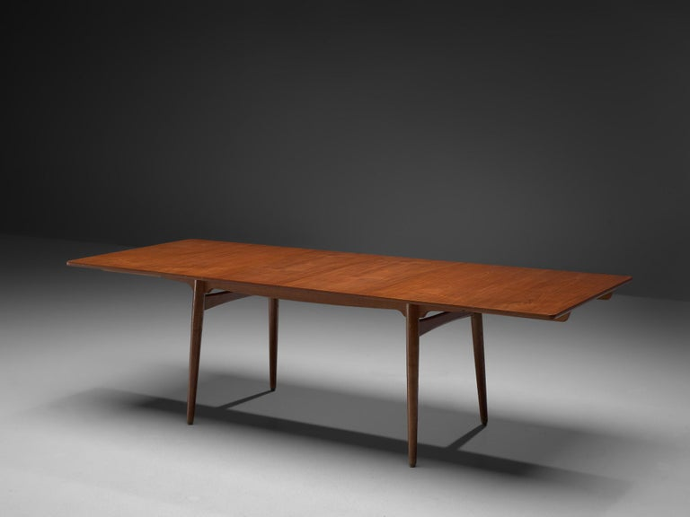 Hans J. Wegner for Andreas Tuck, 'AT-310', teak and oak, Denmark, 1950s.  This extendable AT-310 dining table designed by Hans J. Wegner is made with a teak top and has extra leaves in order to expand the piece from a six-seat (160cm) to a