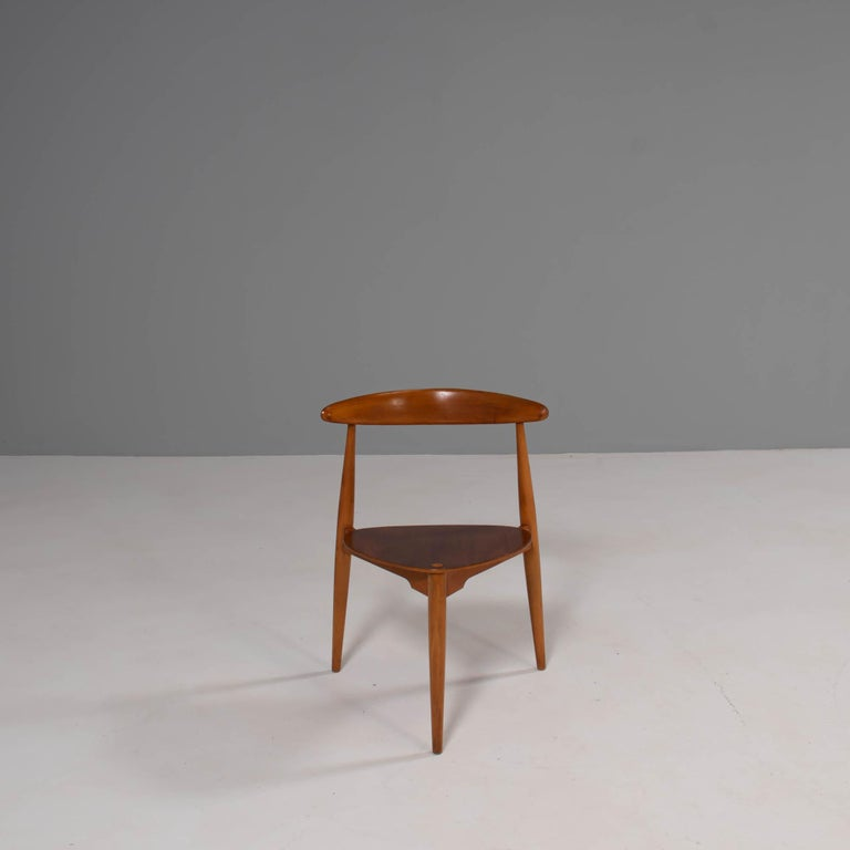 Originally designed by Hans Wegner in the 1950s, the FH4103 was manufactured by Fritz Hansen and sold in London by Story's of Kensington.  Constructed from beech and teak wood, the FH4103 chairs are also known as the 'heart' chairs, due to their