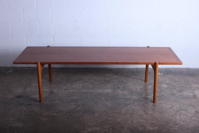 Hans Wegner for Johannes Hansen, Denmark, 1950s. A reverse topped coffee table with oak frame, stamped by maker, and a top of teak on one side and black formica on the other.
