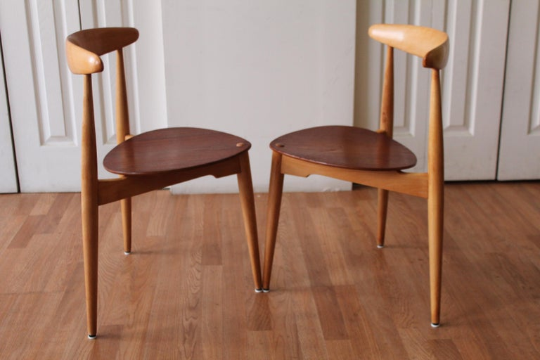 Purist alert! This pair of Danish modern stacking dining chairs is made of teak and beech. The seat is teak and the frame is beech. Freshly waxed, just for you. The
