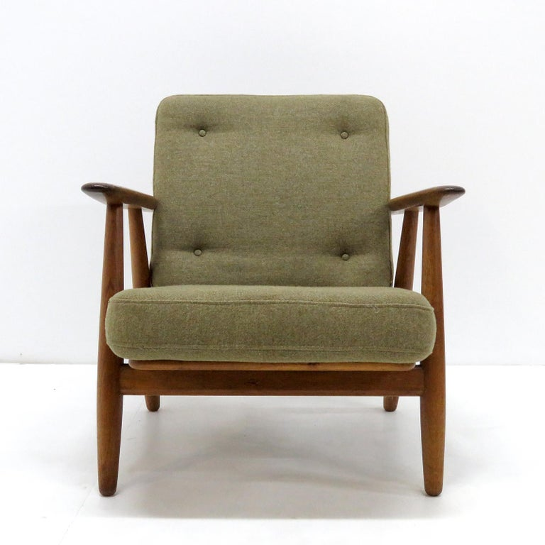 Large-scale Model GE-240 armchairs 'Cigar', designed by Hans Wegner for GETAMA in 1955 with solid oak frames and original cushions in greenish wool, marked. Priced individually.