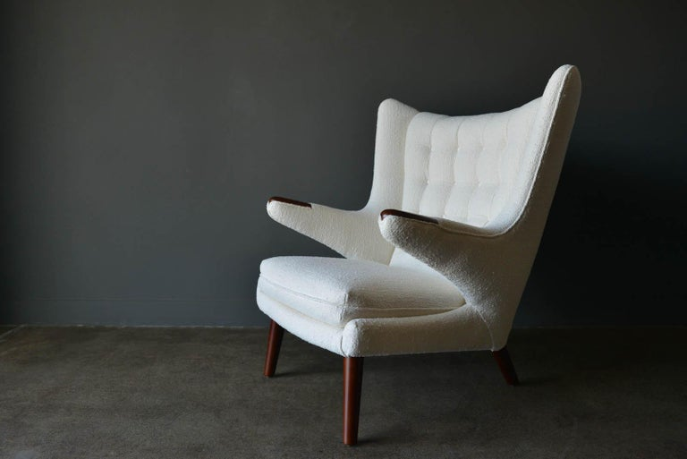 Hans Wegner model AP-19 'Papa Bear' chair, circa 1955. Considered one of his finest and most desirable and comfortable chairs, this beautiful original piece has been professionally restored with new foam and a period-correct ivory textured combed