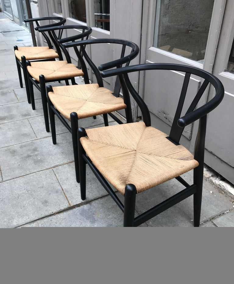 The most successful Wegner design. Comfortable and beautiful they can be used as dining or side chairs.  These are older examples in good condition Papercord, wood, lacquer Measures: H 71.12 cm x W 48.26 cm x D 43.18 cm.