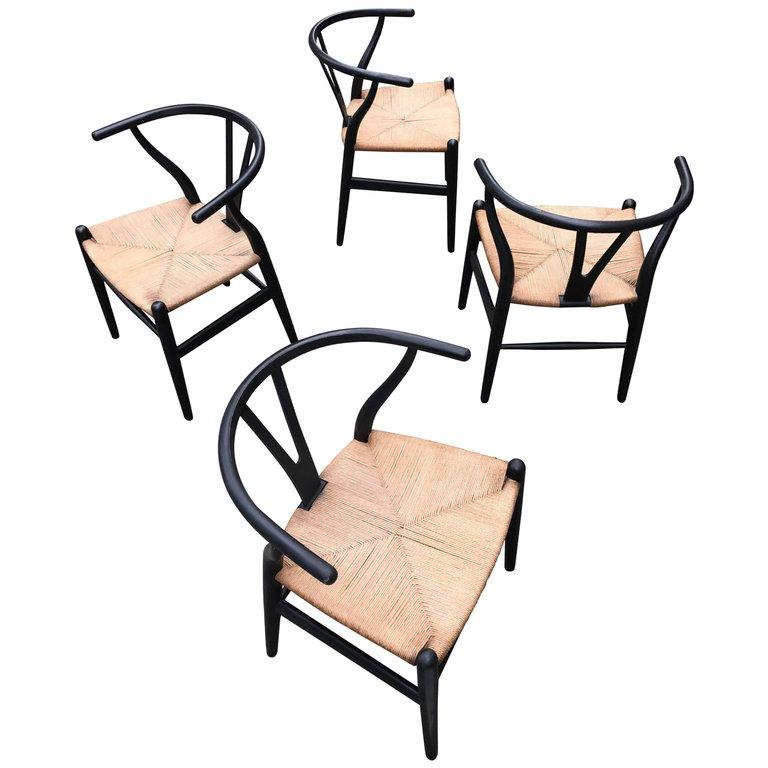 Four Hans Wegner model CH24 chairs, 1949, offered by Formelibre