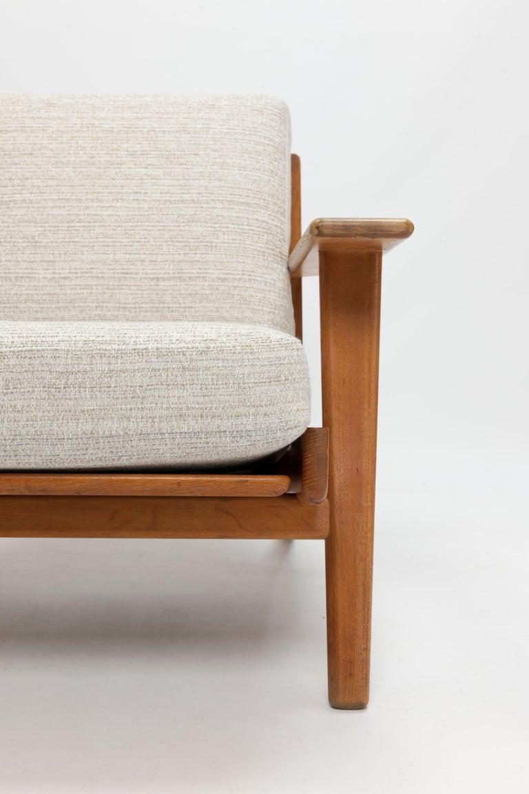 Scandinavian Modern Hans Wegner Oak Lounge Chair GE290 by GETAMA '1 of 3 Chairs'