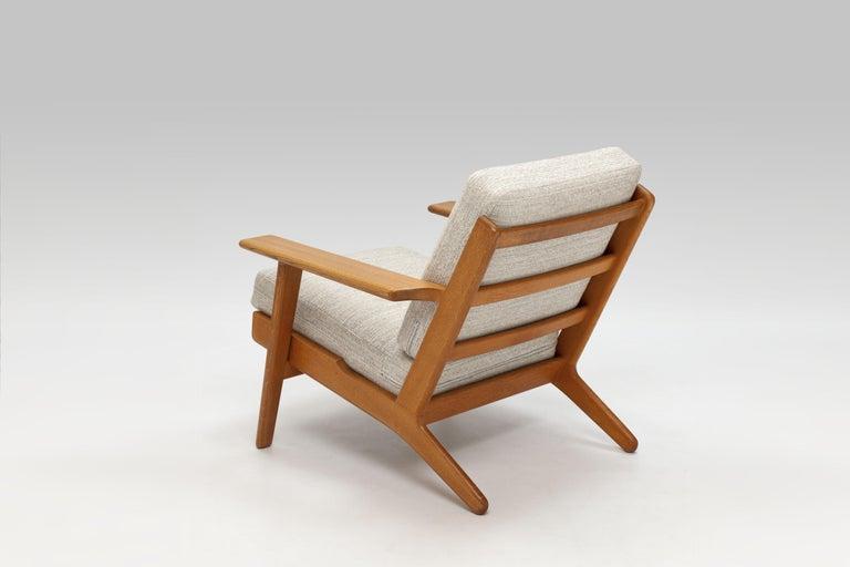 Mid-20th Century Hans Wegner Oak Lounge Chair GE290 by GETAMA '1 of 3 Chairs'