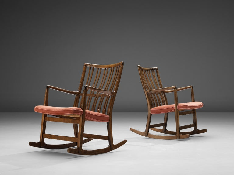 Hans Wegner for Mikael Laursen, pair of ML-33 rocking chairs, beech,fabric upholstery, Denmark, 1940s  Hans Wegner designed the 'ML-33' rocking chair for Laursen in the 1940s. The wooden frame featured an elegant backrest with slim, vertical slats