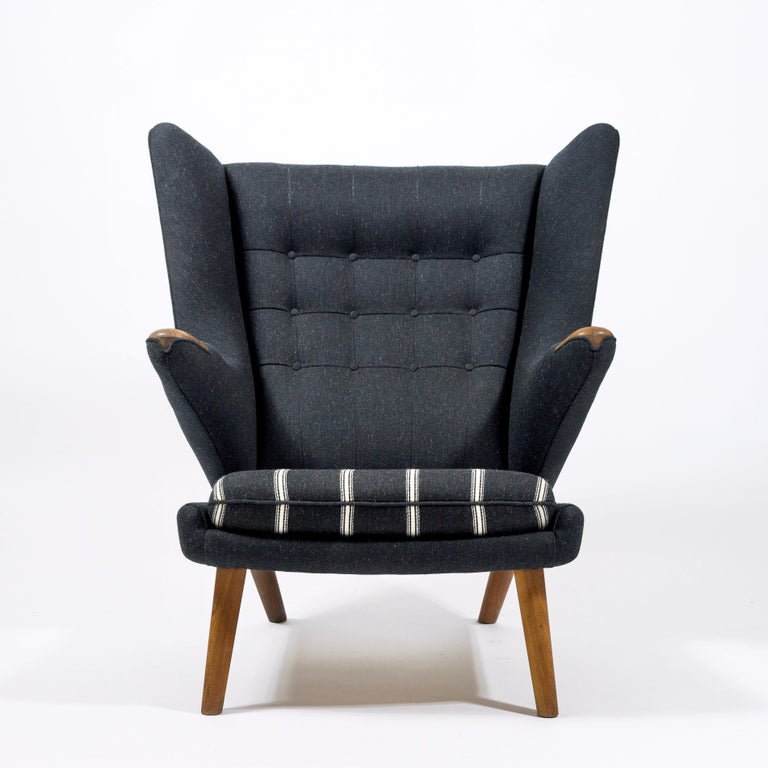 First series of AP 19 lounge chair also called Papa bear chair designed by Hans J. Wegner and manufactured by A.P. Stolen Bamse, Denmark, 1951. New upholstery.