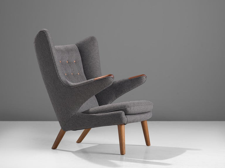 Hans J. Wegner, lounge chair Model AP 19 'Papa Bear, fabric and oak, Denmark, 1951 design, production later,  This semi-wingback armchair, has an open expression in contrast with its historical ancestors. Wegner made a few considerations about