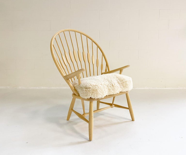 Scandinavian Modern Hans Wegner Peacock Chair with Custom Sheepskin Cushion For Sale