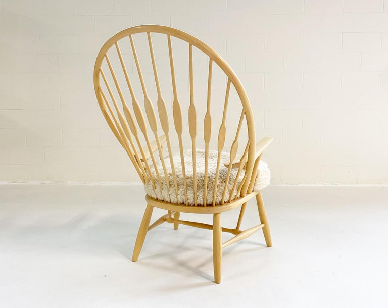 20th Century Hans Wegner Peacock Chair with Custom Sheepskin Cushion For Sale